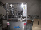 OMB ET-1000 Capping and labelling machine