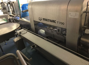 Used Multivac T700 packaging line with metal detection and labelling
