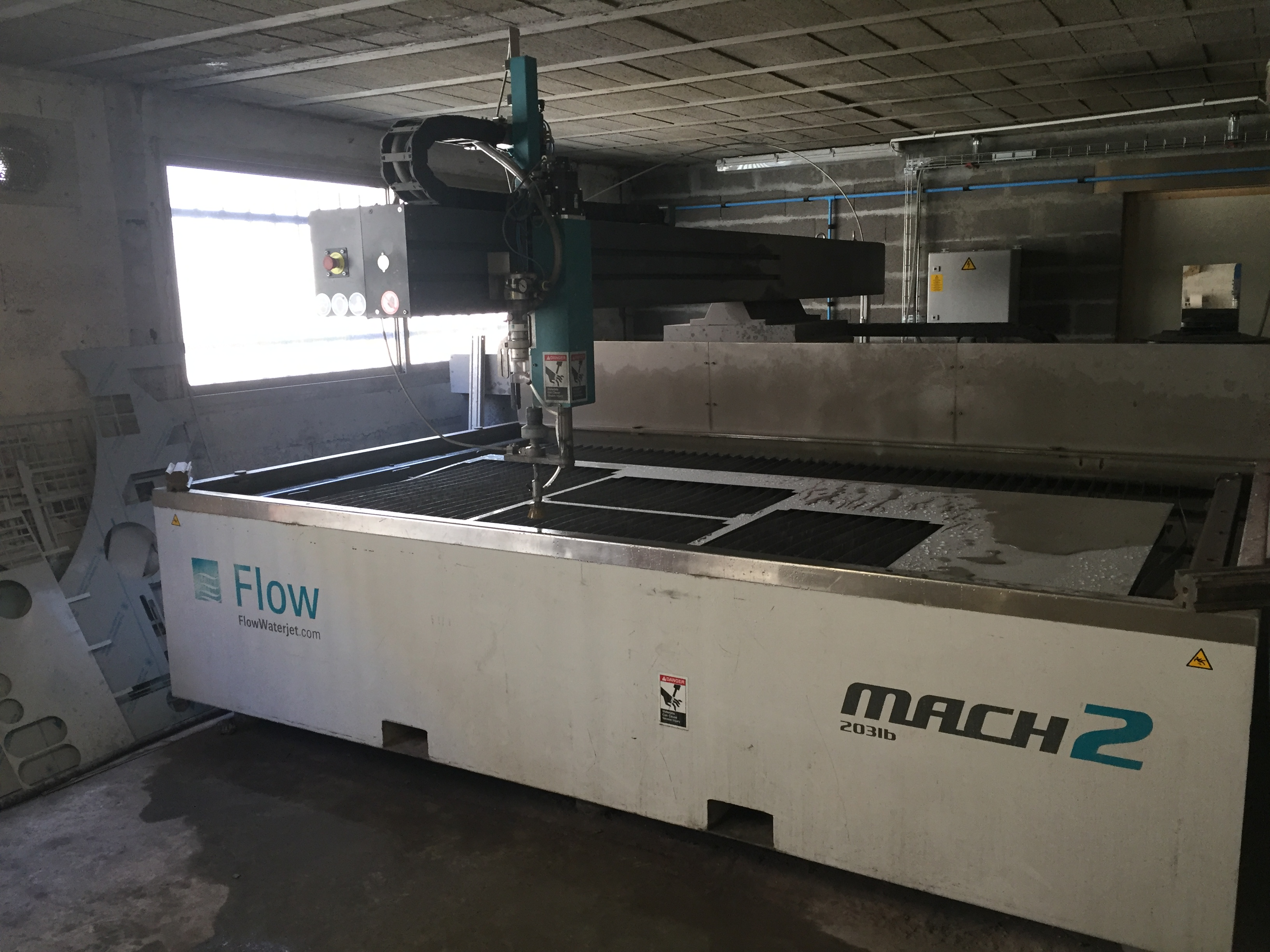 Flow Mach 2 waterjet cutting machine - Exapro