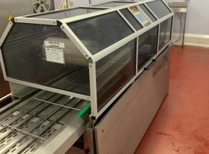 Stroj na balení vaniček do fólie Henkovac TPS 2000