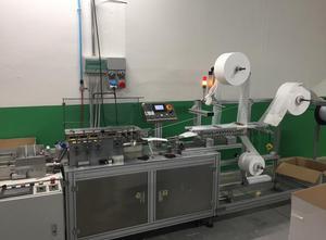 Balící stroj Mask Line  70 p/min - Automatický stroj na výrobu netkaných chirurgických masek pro děti.
