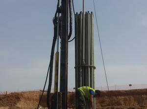 Geothermal drilling rig for vertical boreholes