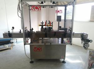 SCM  Costruzioni Meccaniche LINE LAT - Labeling machine for containers adaptable to industrial lines or manual loading. Variable data printing