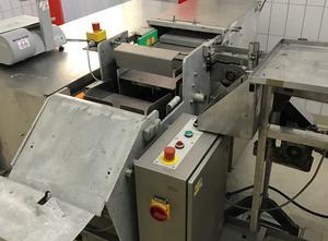 Maszyna do produkcji masła, porcjowania i pakowania SIG  ECOPACK F100
